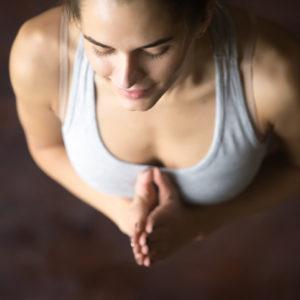 A woman in mountain pose in yoga.