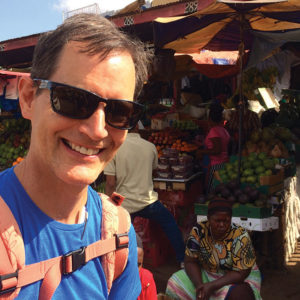 Paul Sutherland in Ugandan market