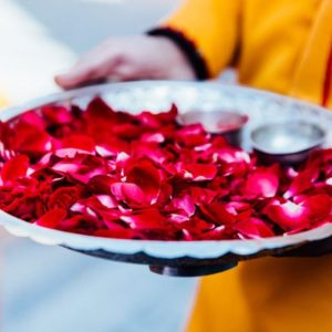 Ashram boy with tray of rose petals