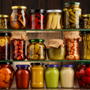 Variety of pickled vegetables in jars