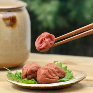 Pickled Plums with chopsticks