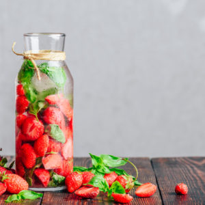 """<img src=""""pitcher with strawberries.jpg"""" alt=""""Bottle of Detox Water Infused with Fresh Strawberry and Basil Leaves""""/>"""