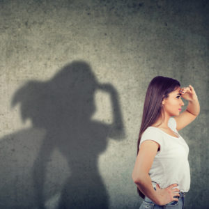 Side view of a woman with superhero shadow