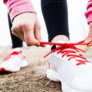 White running shoes with red laces
