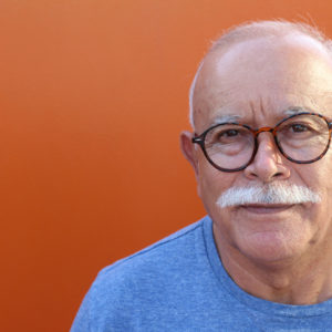 An older man with glasses
