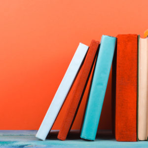 Bright books on orange wall