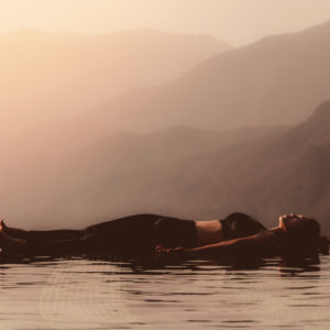 Yoga Pose Savasana or Corpse pose in morning light to bring calm and stress relief