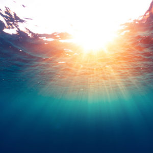 Sun shining through the  surface of the sea