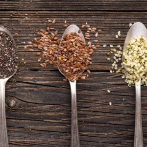 Chia flax and hemp seeds on spoons