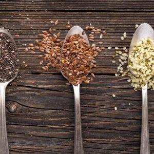 Chia flax and hemp seeds on spoons