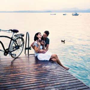 Couple sitting together on dock