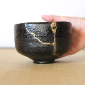 Pottery with golden repair