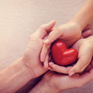 Two hands on heart