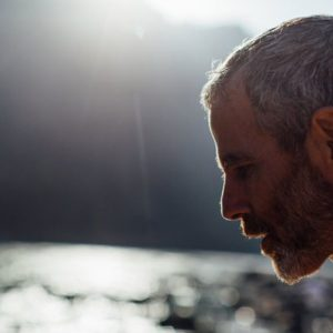 headshot of Tommy Rosen on the Ganges River