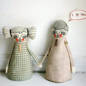 Image of two dolls holding hands
