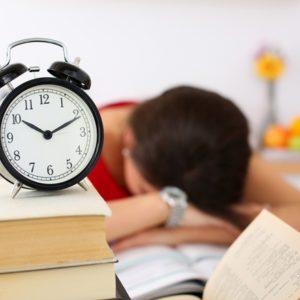 Woman sleeping with clock