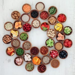 foods in small bowls in circle