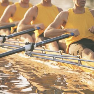 Crew team rowing together