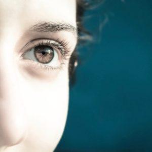 Brown-eyed woman looking toward light
