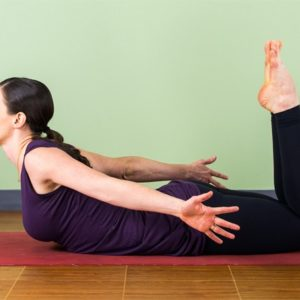 Woman in heart-opening backbend pose