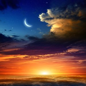 moon in sky over sunset