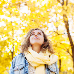 Woman enjoying fall trees