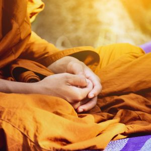 Buddhist monk with hands in lap