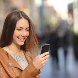 woman happy looking at phone
