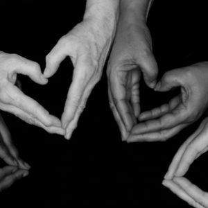 circle of hands making hearts