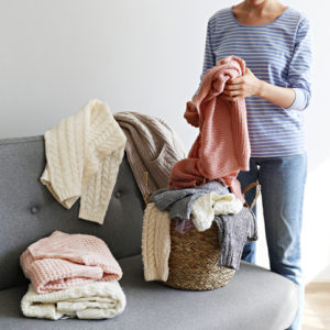Woman sorting her sweaters