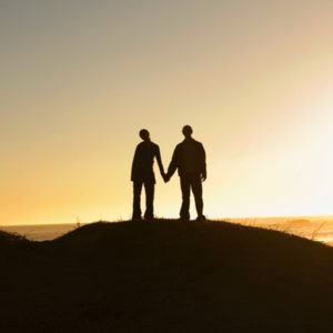 silhouette of couple on hill