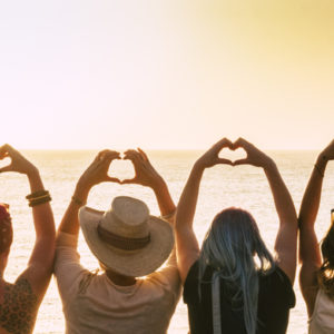 Group of diverse woman unified and peaceful, enjoying the sunset