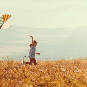 little girl flying kite as ecotherapy