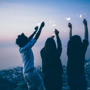 Young people celebrating in the evening