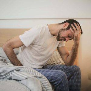 man can't sleep sitting in bed