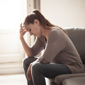 upset woman on couch