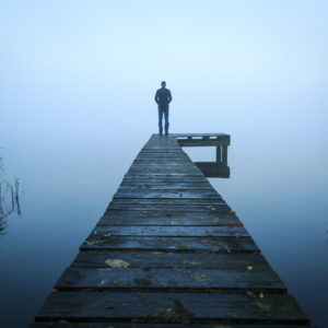 Man in the fog on a dock