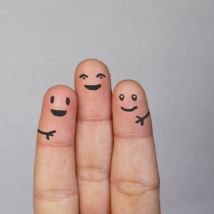 Three fingers smiling