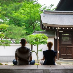 Two people meditating in japanese temple