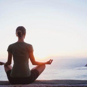 Woman in meditatoin on seaside