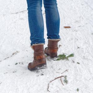 Woman walking on snow