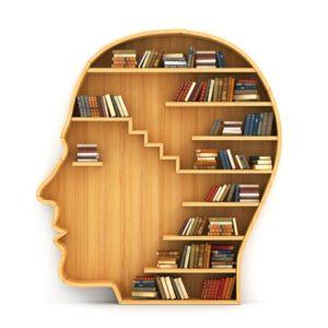 books on wooden head-shaped bookshelf