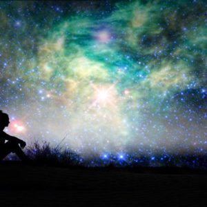 Woman silhouette and cosmic sky