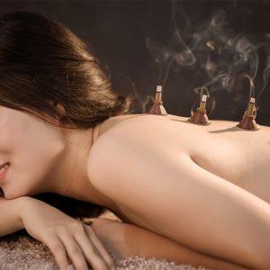 Woman with moxibustion