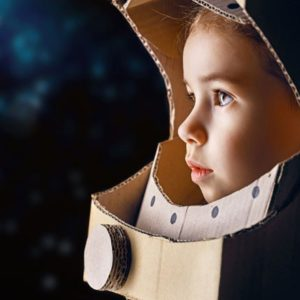 child with astronaut helmet