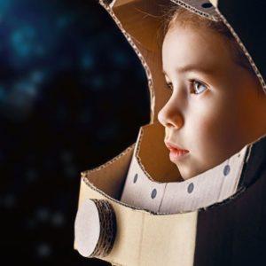 child with astronaut helmet