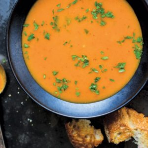 Bowl of Red Soup with Bread