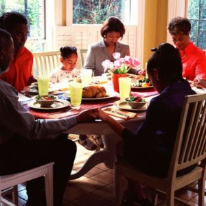Family praying together at table