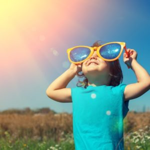 Child looking toward sun