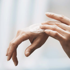 rubbing on hand cream